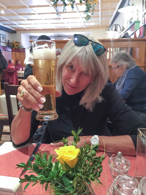 Marci enjoys a beer at a cafe in Berchtesgaden before heading up the Obersalzburg