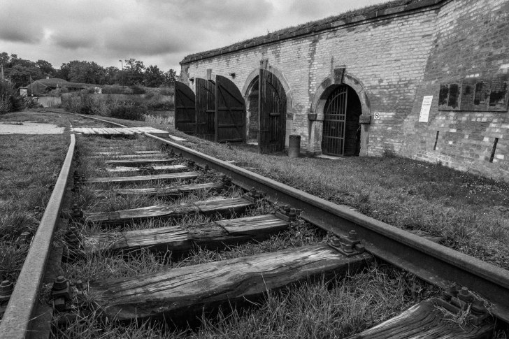 Train tracks into Terezin were added after the Nazis discovered jews talking to locals during the 3 kilometer walk to the train station when being transported to Auschwitz.